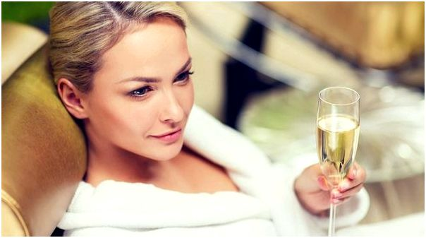 Woman drinking wine in a spa (Syda Productions/Shutterstock)